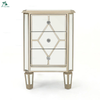 Silver finished mirrored 3 drawer cabinet with faux wood frame
