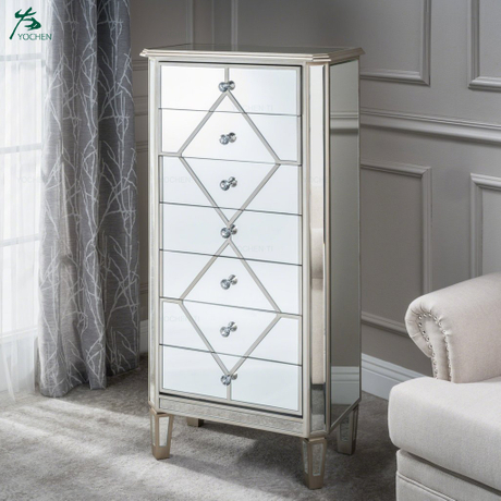 Silver finished mirrored 7 drawer cabinet with faux wood frame