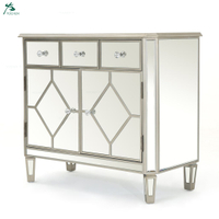 Silver finished mirrored 5 drawer cabinet with faux wood frame